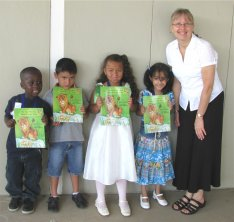 Lucy Read Pre-K receives copies of The Lion Who Saw Himself in the Water