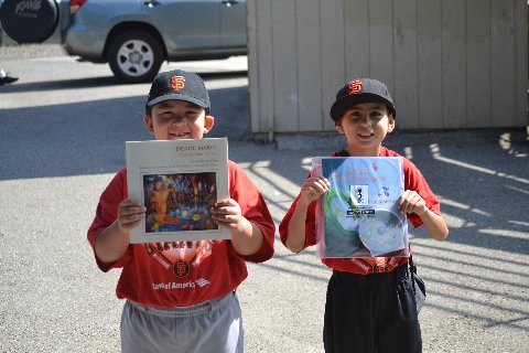 Two Jr. Giants hold Hoopoe books