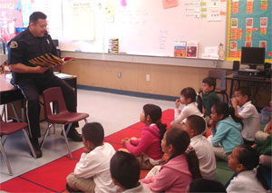 Officer Reads to classroom