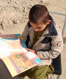 Afghan Boy reading