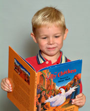 Boy reading The Silly Chicken