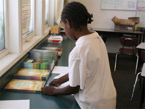 East Palo Alto (CA) student sorting gift books