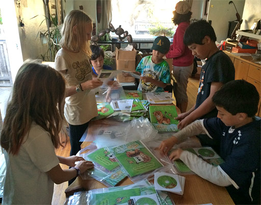 Kids packing home literacy kits